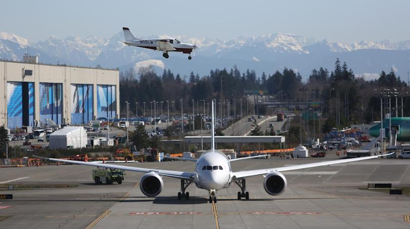A Boeing 787 taxis as a small plane lands on Monday, March 25, 2013 at Paine Field in Everett. This was the first test flight of a 787 since the fleet was grounded because the danger of a fire with the lithium-Ion battery in the plane. (Associated Press/seattlepi.com, Joshua Trujillo)