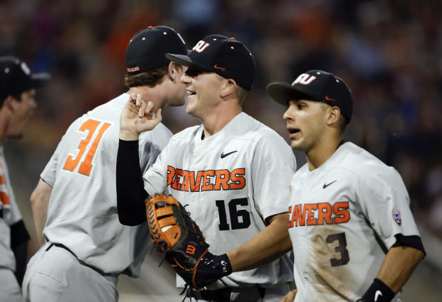 Oregon State first baseman Zak Taylor (16) smiles after a double play against Mississippi State ended the sixth inning of an NCAA College World Series baseball elimination game in Omaha, Neb., Saturday, June 23, 2018. (AP Photo/Nati Harnik)