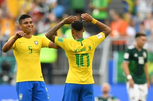 Casemiro celebrating with Neymar at the end of Brazil's 2-0 win over Mexico -- but the Real Madrid man will be banned for the quarter-final against Belgium