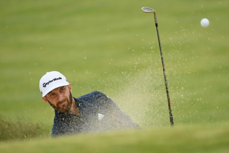 Dustin Johnson of the US plays a shot from a bunker on the 11th hole during a practice round prior to the 2018 US Open, at Shinnecock Hills Golf Club in Southampton, New York, on June 13