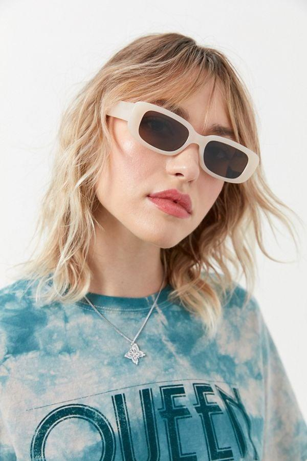 """<p>We're kind of into the white sunglasses trend, and these <a href=""""https://www.popsugar.com/buy/Sausalito-Rectangle-Sunglasses-547624?p_name=Sausalito%20Rectangle%20Sunglasses&retailer=urbanoutfitters.com&pid=547624&price=16&evar1=fab%3Aus&evar9=47190518&evar98=https%3A%2F%2Fwww.popsugar.com%2Ffashion%2Fphoto-gallery%2F47190518%2Fimage%2F47191086%2FSausalito-Rectangle-Sunglasses&list1=shopping%2Csunglasses%2Caccessories%2Cfashion%20shopping%2Cbest%20of%202020&prop13=mobile&pdata=1"""" rel=""""nofollow"""" data-shoppable-link=""""1"""" target=""""_blank"""" class=""""ga-track"""" data-ga-category=""""Related"""" data-ga-label=""""https://www.urbanoutfitters.com/shop/sausalito-rectangle-sunglasses?category=womens-sunglasses&amp;color=012&amp;quantity=1&amp;size=ONE%20SIZE&amp;type=REGULAR"""" data-ga-action=""""In-Line Links"""">Sausalito Rectangle Sunglasses</a> ($16) are so fun.</p>"""