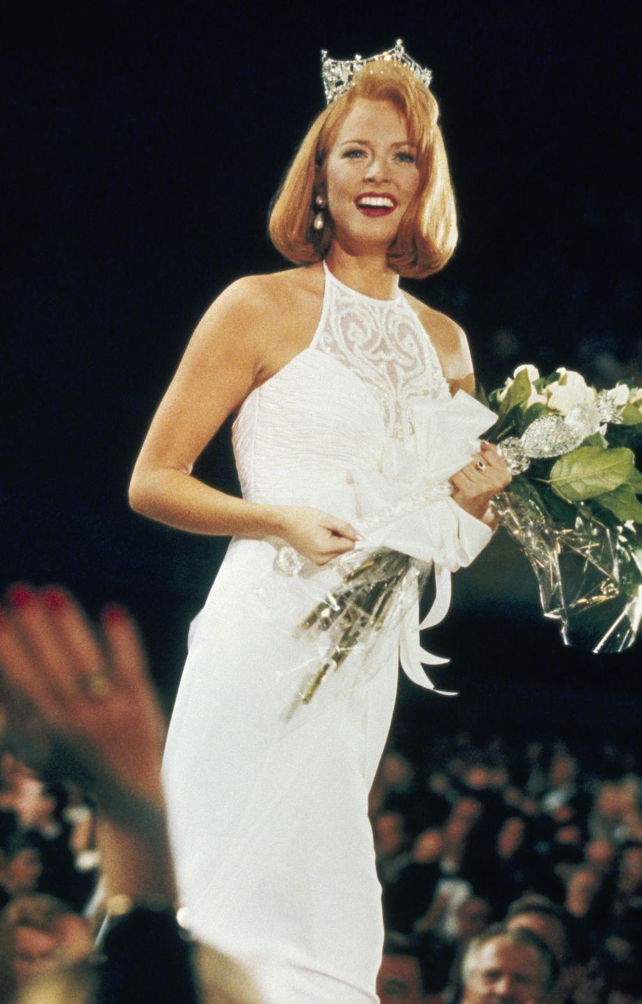 <p>In the mid-'90s, halter tops were one of the biggest trends out there. Shawntel Smith from Oklahoma chose the iconic style for the competition, and she took home the title in 1996. </p>