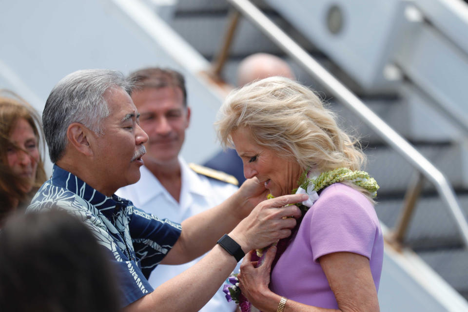 First lady Jill Biden receives a lei of flowers from Hawaii Gov. David Ige on the tarmac after arriving at Joint Base Pearl Harbor-Hickam, Hawaii, Saturday, July 24, 2021. (Jamm Aquino/Honolulu Star-Advertiser via AP)