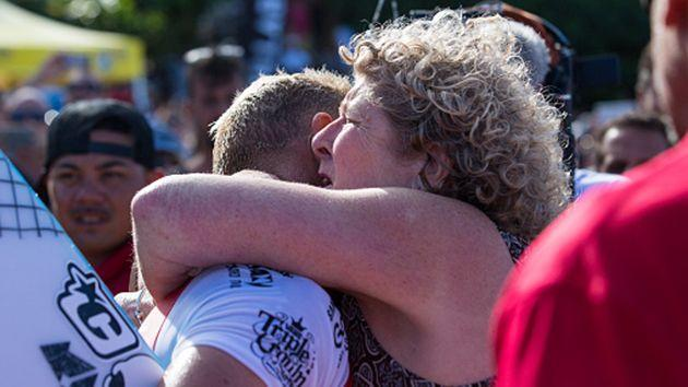 Fanning hugs his mother after competing. Image: Getty