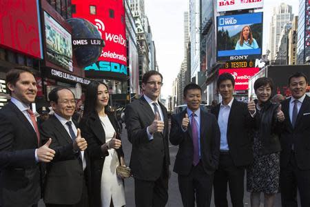 Weibo Corporation Chairman Charles Chao poses after a visit to the NASDAQ MarketSite in Times Square in celebration of its initial public offering (IPO) on The NASDAQ Stock Market in New York