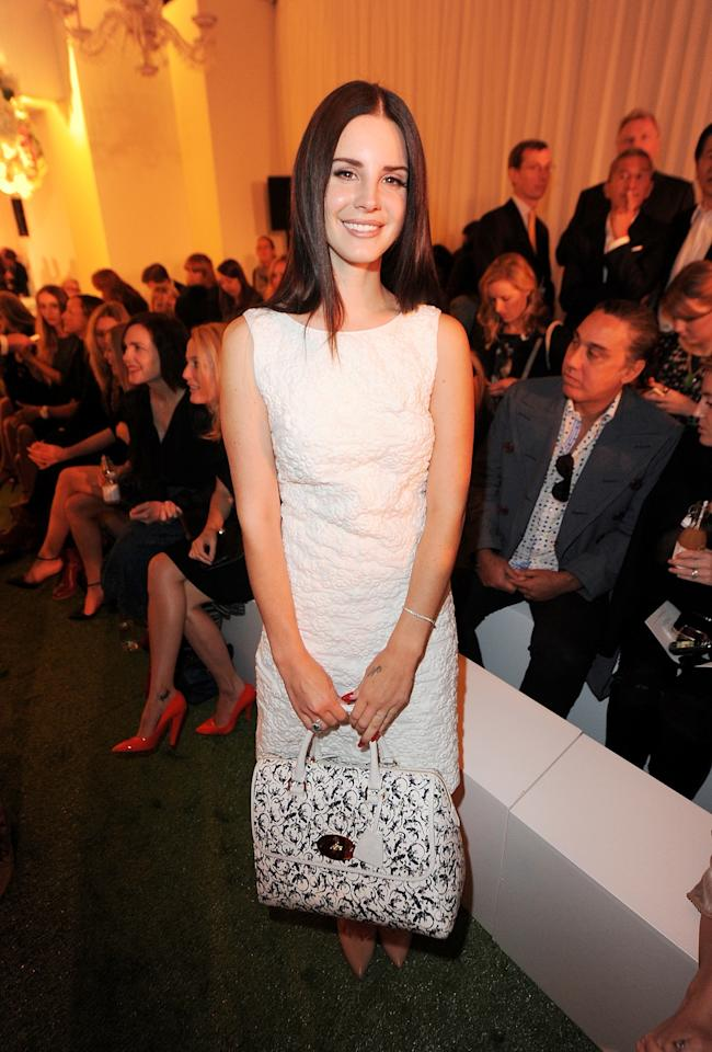 "<p class=""MsoNormal""><span>Singer Lana Del Rey wore a simple yet elegant white dress for the Mulberry Spring/Summer 2013 Show. <br></span></p><p class=""MsoNormal""><span>(Photo by Dave M. Benett/Getty Images)</span></p>"