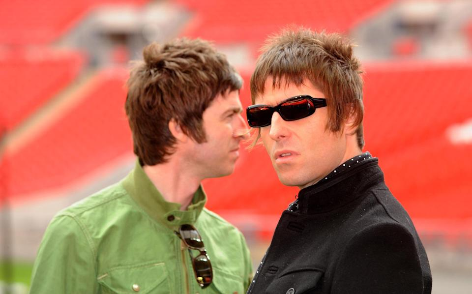 Oasis band members Noel Gallagher and Liam Gallagher are pictured during a photocall at Wembley Stadium, where they announced their biggest ever tour of open air venues in the UK and Ireland next summer.   (Photo by Zak Hussein - PA Images/PA Images via Getty Images)