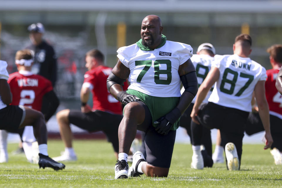New York Jets offensive lineman Morgan Moses (78) stretches during practice at the team's NFL football training facility, Saturday, July. 31, 2021, in Florham Park, N.J. (AP Photo/Rich Schultz)