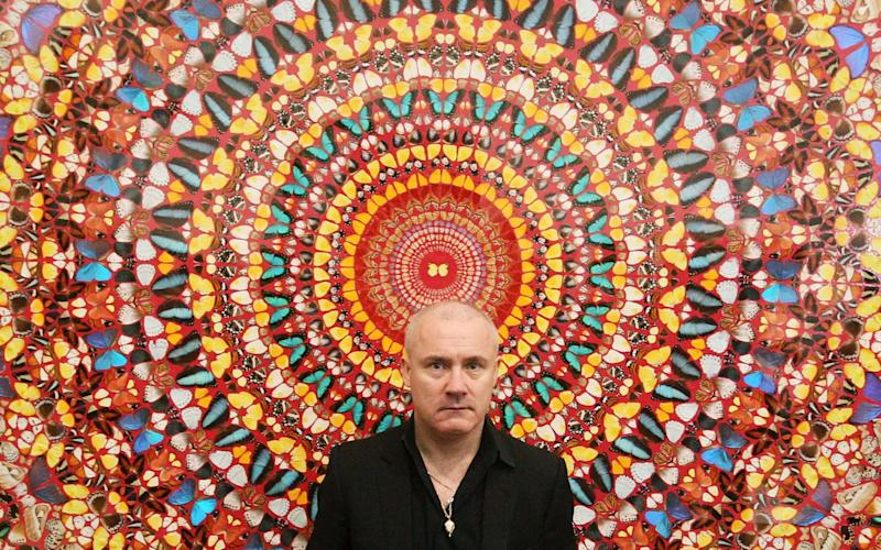 Damien Hurst with his work 'I Am Become Death, Shatterer of Worlds 2006'