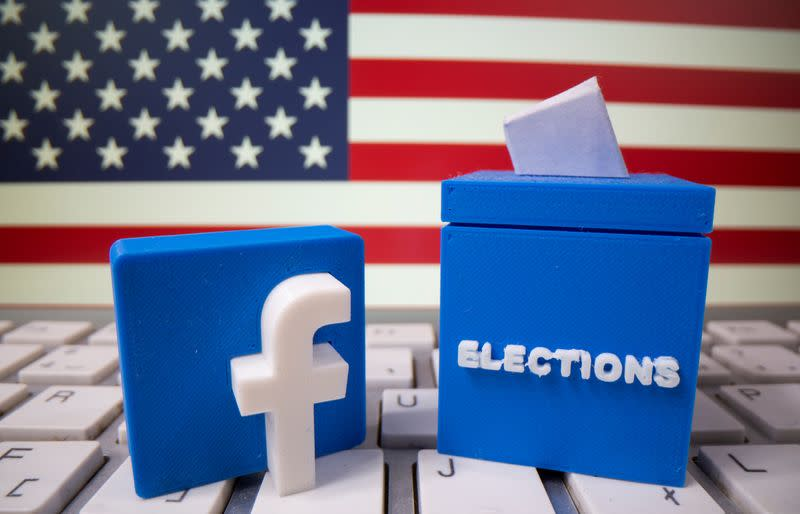 FILE PHOTO: A 3D-printed elections box and Facebook logo are placed on a keyboard in front of U.S. flag in this illustration