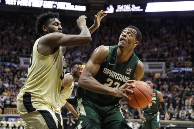 Michigan State forward Xavier Tillman (23) shoots over Purdue forward Trevion Williams (50) during the first half of an NCAA college basketball game in West Lafayette, Ind., Sunday, Jan. 12, 2020. (AP Photo/Michael Conroy)