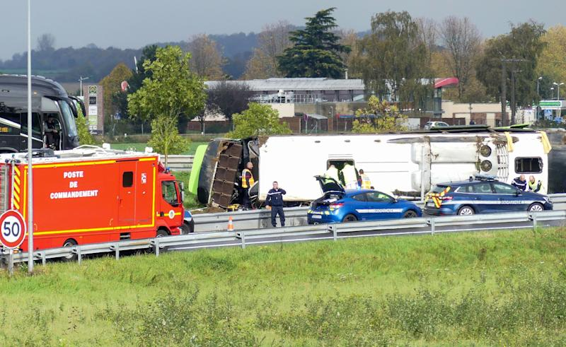 Emergency services are at work on the site of an accident after a bus from the Flixbus company overturned as it took an exit from the A1 motorway, injuring 29 passengers and seriously wounding 4, on November 3, 2019 near Berny-en-Santerre, northern France. (Photo by - / AFP) (Photo by -/AFP via Getty Images)