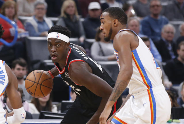 Toronto Raptors forward Pascal Siakam, left, drives past Oklahoma City Thunder guard Terrance Ferguson during the first half of an NBA basketball game Wednesday, Jan. 15, 2020, in Oklahoma City. (AP Photo/Sue Ogrocki)
