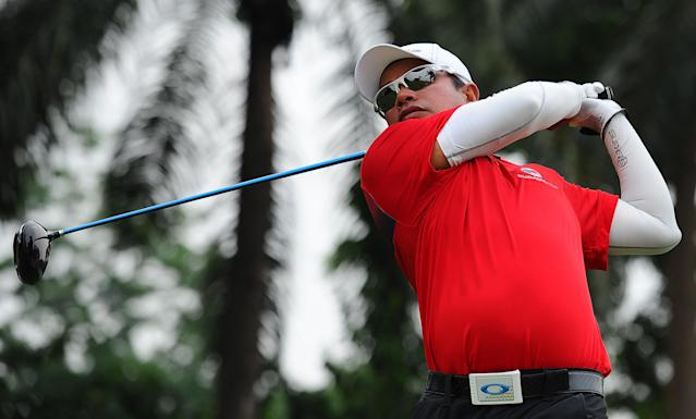 Thailand's Prayad Marksaeng watches his shot on the sixth hole during the third round of the EurAsia Cup golf tournament at the Glenmarie Golf and Country Club in Subang, Malaysia, Saturday, March 29, 2014. (AP Photo/Joshua Paul)