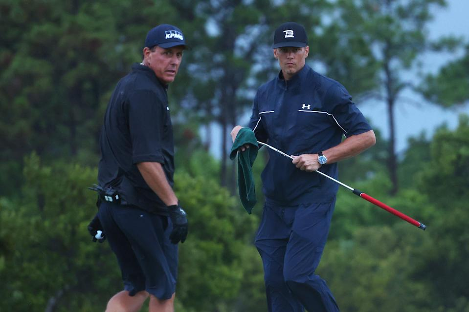 Phil Mickelson reads a putt for Tom Brady during The Match on May 24, 2020 in Hobe Sound, Florida.