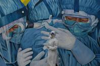 This mural at a clinic in Malaysia pays tribute to the work of the health workers there