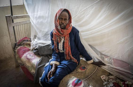 Akram, 14, is treated for malaria in Zamzam camp amid an 'unprecedented' outbreak of the disease in north Darfur (Bel Trew)