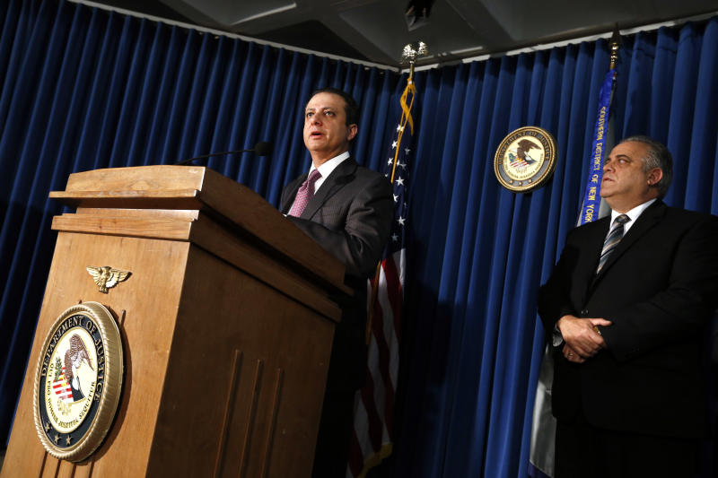 U.S. Attorney Preet Bharara, left, announces charges against more than a dozen Russian diplomats and their spouses living in New York during a news conference Thursday, Dec. 5, 2013 in New York. The charges stem from the defendants' alleged involvement in a $1.5 million fraud of a U.S. government health program for the poor. (AP Photo/Jason DeCrow)