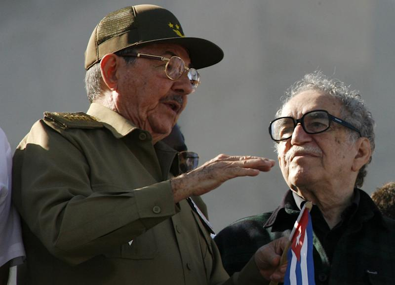 FILE - In this Dec. 2, 2006 file photo, Cuba's acting President Raul Castro, brother of Cuban leader Fidel Castro, left, chats with Colombian Nobel laureate Gabriel Garcia Marquez during a military parade in Havana, Cuba. Marquez died on Thursday, April 17, 2014 at his home in Mexico City. (AP Photo/ Javier Galeano, File)
