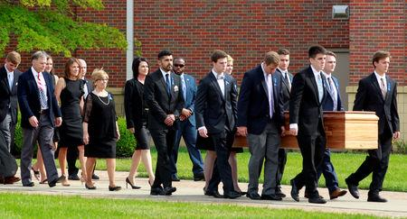 FILE PHOTO: Fred and Cindy Warmbier follow the casket of their son, Otto Wambier, to the hearse after his funeral in Wyoming