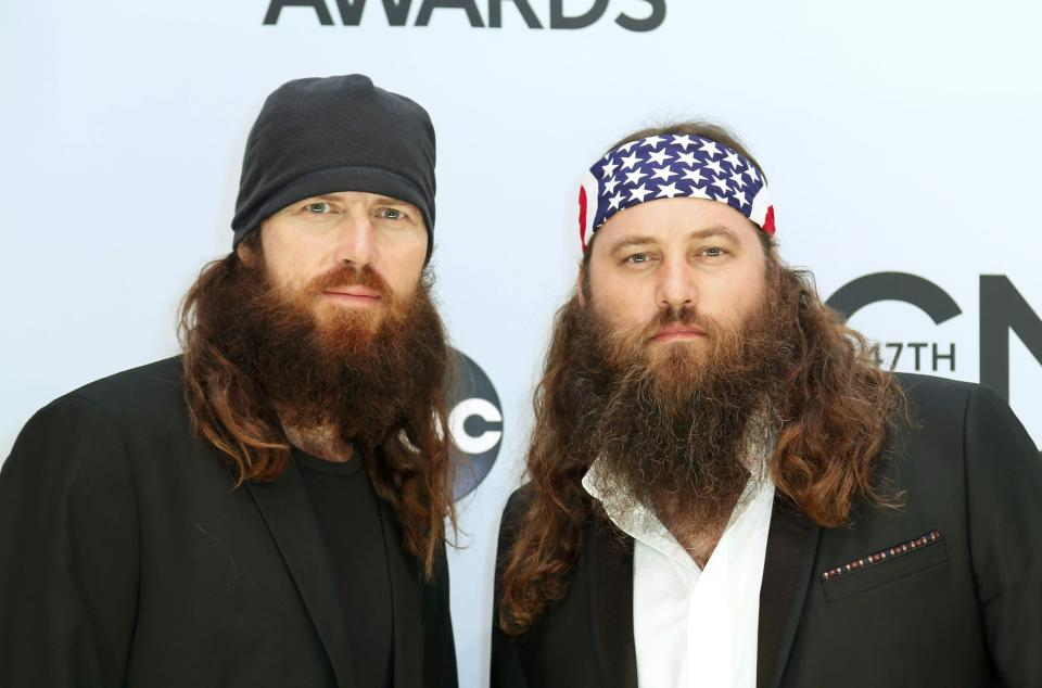 Jase Robertson (L) and Willie Robertson from the Duck Dynasty TV show pose on arrival at the 47th Country Music Association Awards in Nashville, Tennessee November 6, 2013. REUTERS/Eric Henderson (UNITED STATES - Tags: ENTERTAINMENT)