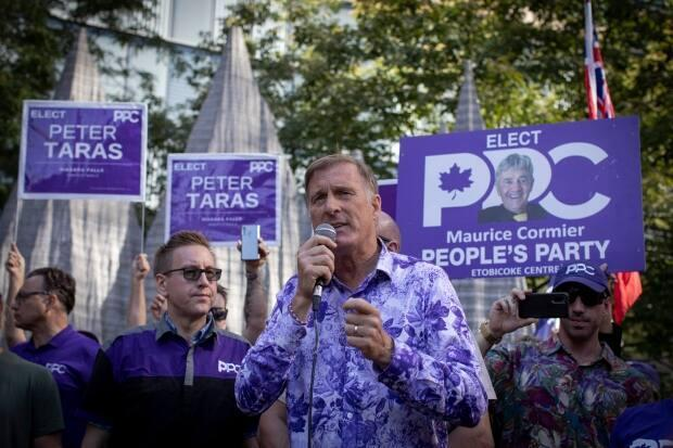 People's Party of Canada supporters take part in a rally outside the CBC building, in Toronto, on Sept. 16, 2021. Leader Maxime Bernier did not win a seat in the Sept. 21  election. (Evan Mitsui/CBC - image credit)