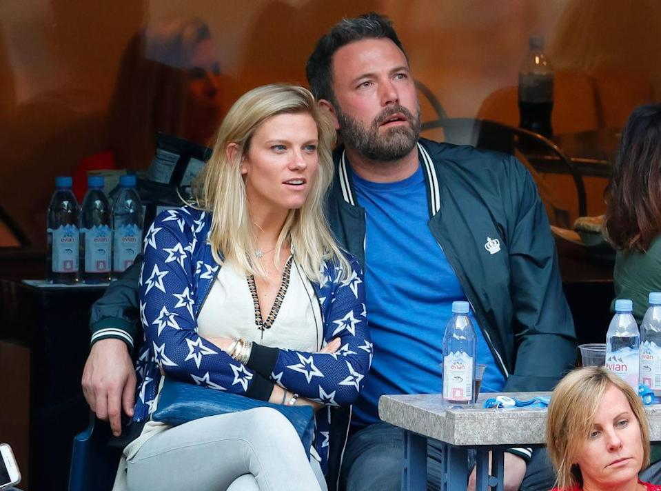 Lindsay Shookus and Ben Affleck cuddle while attending the US Open.