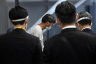 Yuki Kitazumi, a Japanese freelance journalist detained by security forces in Myanmar in mid-April and accused of spreading fake news criticizing the military coup, bows after speaking to media upon his arrival at Narita International Airport, in Narita, east of Tokyo. (AP Photo/Eugene Hoshiko)