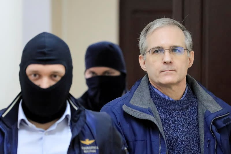FILE PHOTO: Former U.S. Marine Paul Whelan, who was detained and accused of espionage, is escorted inside a court building in Moscow