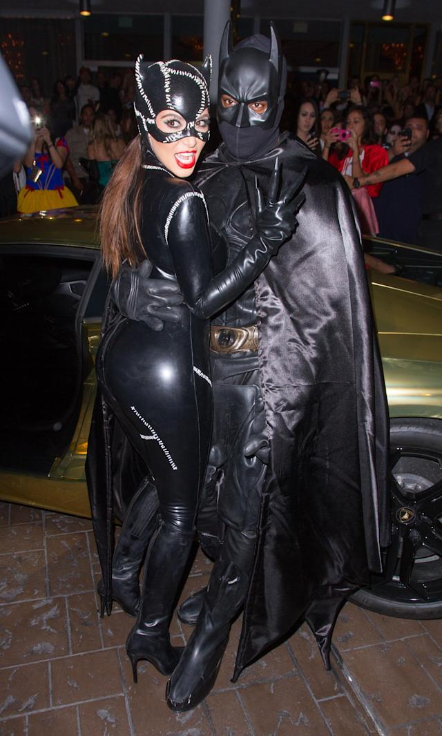 <p>Before Jaden Smith sported a Batman costume at their wedding, Kimye went to Gotham. Kanye was the one sporting the Dark Knight's uniform, and Kim played his fellow DC Comics star Catwoman. (Photo: Getty Images) </p>