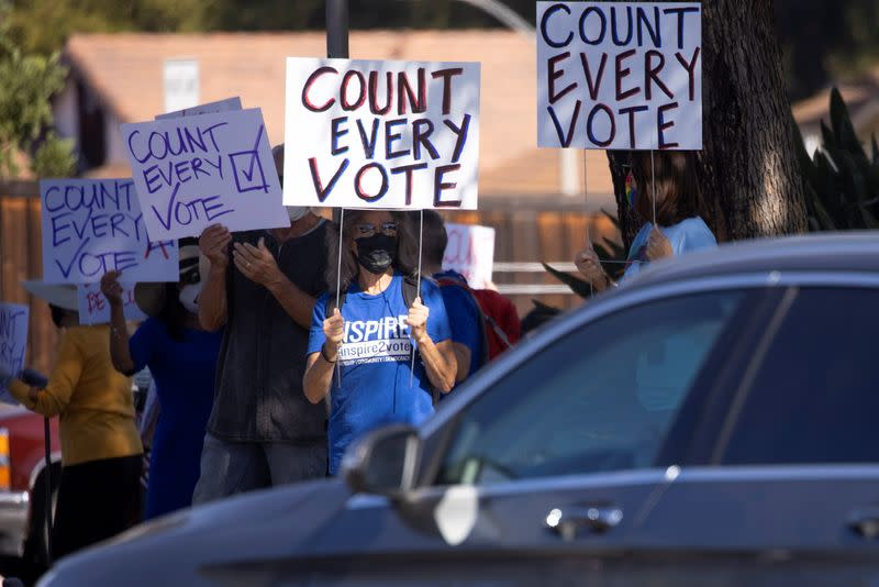Demonstrators from protect the results coalition protests against efforts to not count all the votes in the general election as they demonstrate in Poway, California