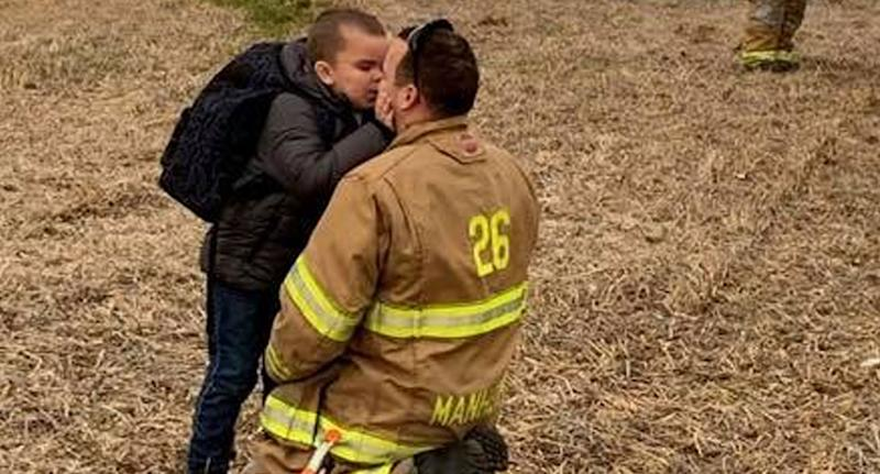 Photo of disabled boy Jojo embracing firefighter Andrew Kirchner at scene of bus crash in Pennsylvania.
