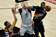 Washington Wizards center Alex Len (27) is fouled by Phoenix Suns forward Jae Crowder (99) during the second half of an NBA basketball game, Saturday, April 10, 2021, in Phoenix. (AP Photo/Matt York)