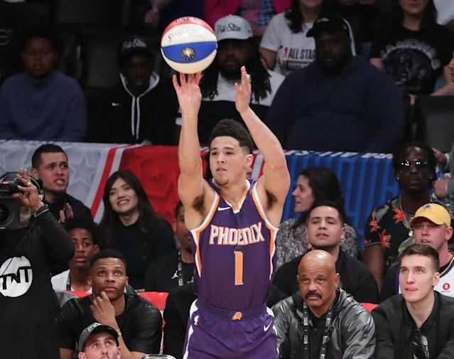 Phoenix Suns guard Devin Booker strokes the money ball. (Getty)