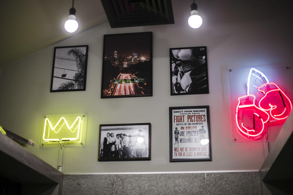 Visuals and posters on the walls of CruBox Singapore.