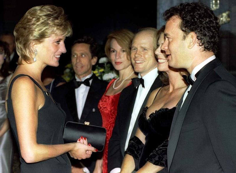 Diana speaks with actor Tom Hanks at the premiere of Apollo 13 in September 1995 [Photo: PA]