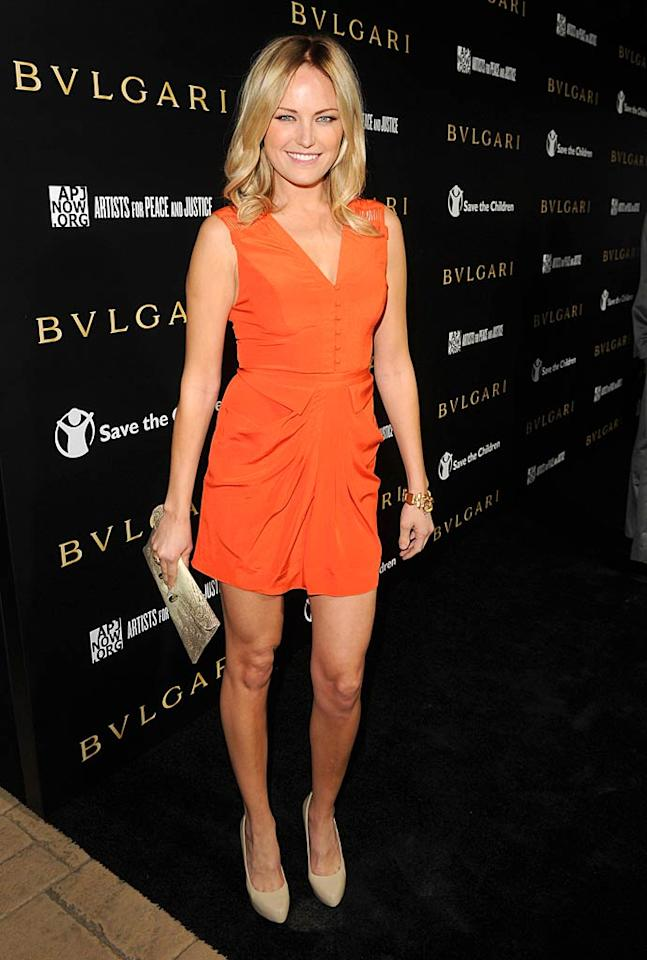 """Malin Akerman, who has taken over Lindsay Lohan's role in the Linda Lovelace biopic """"Inferno,"""" was a tangerine dream in her brightly-colored mini. Jason Merritt/<a href=""""http://www.gettyimages.com/"""" target=""""new"""">GettyImages.com</a> - January 13, 2011"""