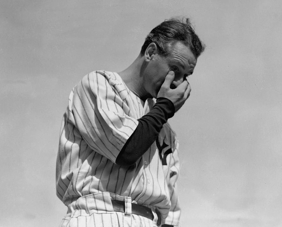 FILE - New York Yankees' Lou Gehrig wipes away a tear while speaking during a sold-out tribute at Yankee Stadium in New York, in this July 4, 1939, file photo. Major League Baseball will hold its first Lou Gehrig Day on June 2, 2021, adding Gehrig to Jackie Robinson and Roberto Clemente on the short list of players honored throughout the big leagues. (AP Photo/Murray Becker, File)