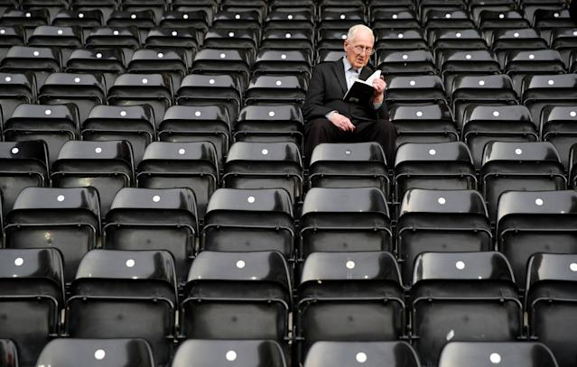 "Soccer Football - League Two Play Off Semi Final Second Leg - Notts County vs Coventry City - Meadow Lane, Nottingham, Britain - May 18, 2018 General view of a fan reading a book in the ground before the match Action Images/Carl Recine EDITORIAL USE ONLY. No use with unauthorized audio, video, data, fixture lists, club/league logos or ""live"" services. Online in-match use limited to 75 images, no video emulation. No use in betting, games or single club/league/player publications. Please contact your account representative for further details."