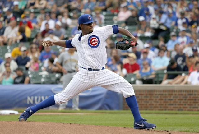 Chicago Cubs starting pitcher Edwin Jackson delivers during the first inning of a baseball game against the Pittsburgh Pirates, Friday, June 20, 2014, in Chicago. (AP Photo/Charles Rex Arbogast)