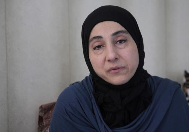 Zubeidat Tsarnaeva, mother of the two Boston bombing suspects, speaks during a meeting of the Tsarnaevs with the AP in their new apartment in Makhachkala, regional capital of Dagestan, Russia, Thursday, May 30, 2013. Authorities accuse Tamerlan Tsarnaev, who was slain in a shootout with police, and his younger brother Dzhokhar of organizing the attacks, which killed three. (AP Photo/Musa Sadulayev)