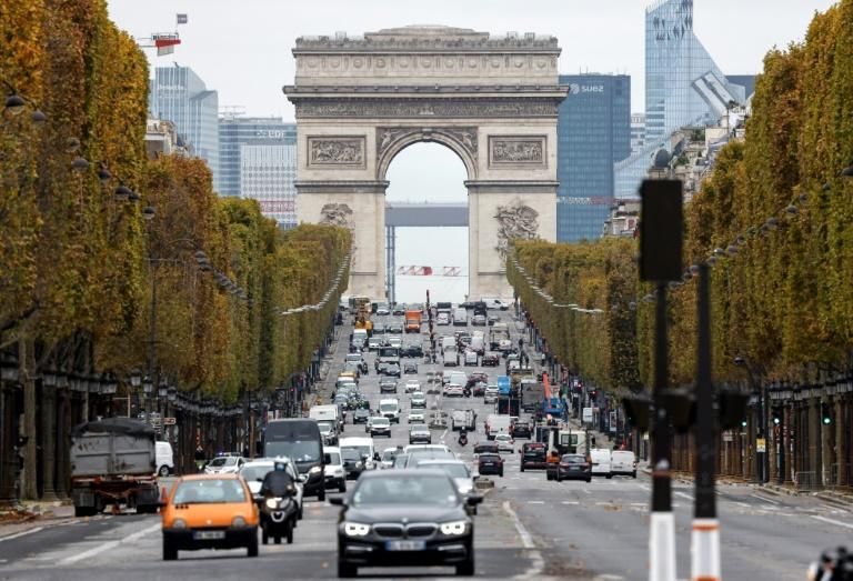 A steady flow of traffic around central Paris on Friday belied the newly imposed lockdown