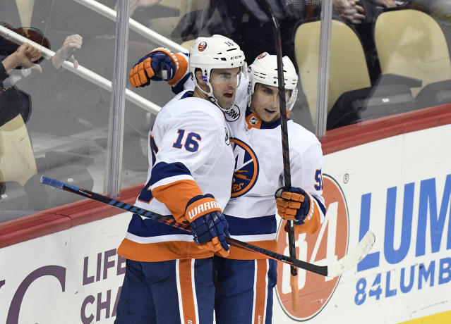 New York Islanders left wing Andrew Ladd (16) celebrates with New York Islanders center Valtteri Filppula (51) after scoring a goal against the Pittsburgh Penguins during the first period of an NHL hockey game in Pittsburgh, Tuesday, Oct. 30, 2018. (AP Photo/Don Wright)