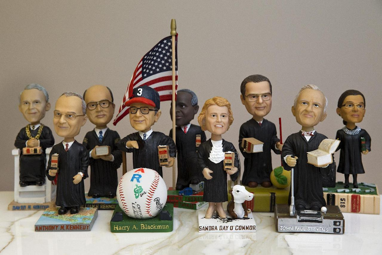This photo taken Nov. 20, 2013 shows bobblehead dolls representing Supreme Court Justices, in Washington. They are some of the rarest bobblehead dolls ever produced. They're released erratically. They're given away for free, not sold. And if you get a certificate to claim one, you have to redeem it at a Washington, DC, law office. The limited edition bobbleheads of U.S. Supreme Court justices are the work of law professor Ross Davies, who has been creating them for the past ten years. When finished, they arrive unannounced on the real justices' desks, secreted there by unnamed confederates. And fans will go to some lengths to get one. (AP Photo/Jacquelyn Martin)