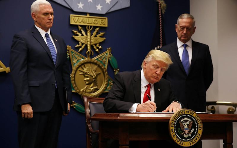 President Donald Trump signed a revised executive order for a travel ban on March 6 - REUTERS/CARLOS BARRIA