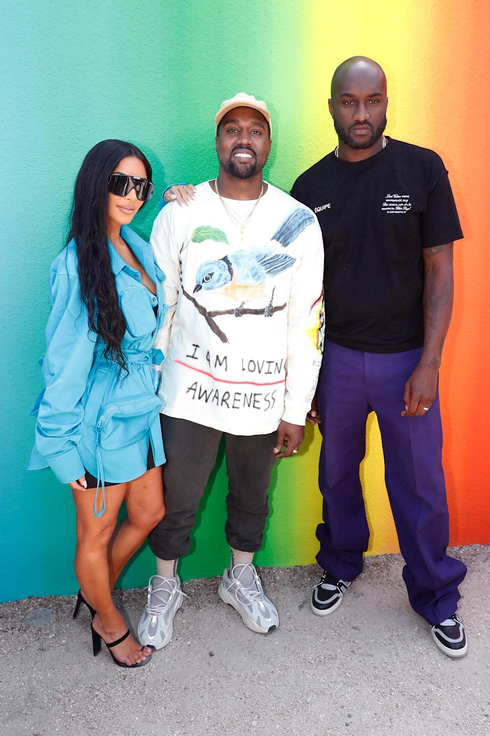 <p>Kim and Kanye made a rare joint appearance at Virgil Abloh's Paris show. For the outing, Kim donned a utilitarian-inspired dress with a co-ordinating belt bag (of course). <em>[Photo: Getty]</em> </p>