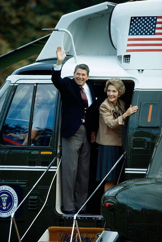 <p>The Reagans were photographed waving as they boarded the presidential helicopter, Marine One. </p>