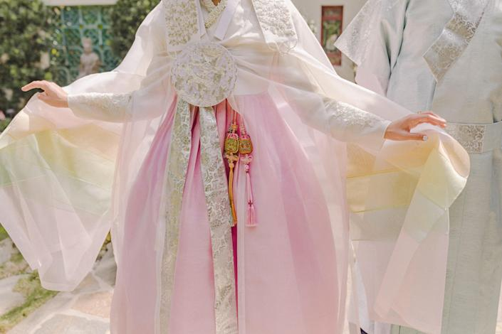 I loved the soft, muted pastel colors of my <em>wonsam</em>, the topcoat I am wearing here. The bright three dangling accessories are called <em>norigae</em>, which dates back to the Joseon dynasty.