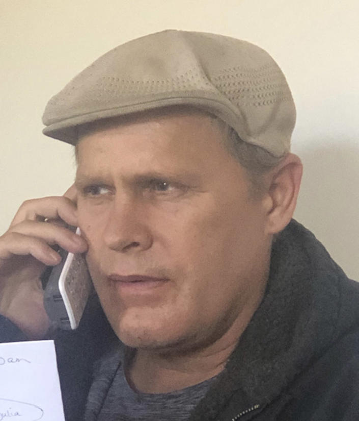 In this photo provided by Vedanta Griffith, Joshua Spriestersbach talks on a phone in March 2020, in Danby, Vt. The Hawaii Innocence Project says, Monday, Aug. 2, 2021, Spriestersbach was wrongfully arrested for someone else's crime and then committed to a state hospital for more than two years because officials mixed him up with someone else. (Vedanta Griffith via AP)