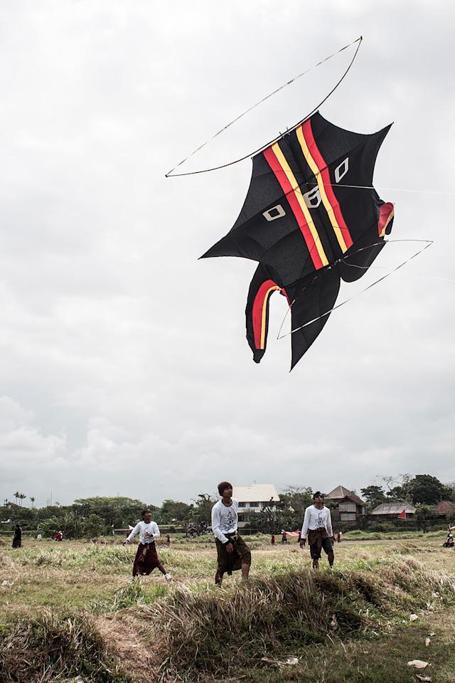 DENPASAR, BALI, INDONESIA - JULY 26: A traditional kite flies the during Bali Kite Festival on July 26, 2013 in Denpasar, Bali, Indonesia. The event is a seasonal religious festival, which is intended to send a message to Hindu Gods to create abundant harvests and crops. Aproximately 1121 traditional kites are flown during the three day annual Festival. (Photo by Putu Sayoga/Getty Images)